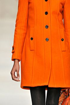 Burberry Prorsum - wouldn't it be fun to have an orange coat like this?