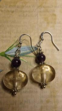 Cute Mini Dangle Earrings  Pretty round amethyst gemstones accent an acrylic oval bead brushed with a dusting of gold. Hangs from a silver french hook ear wire, and measures approx. 1 3/4 inches in lenth. Hand made, brand new & never worn.  What a g...