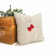 Christmas decorative pillow, Holiday home decor, Throw pillow, Ornament pillow - Brown deer silhouette and red felt bowtie on natural fabric...