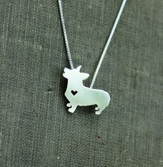 Pembroke corgi necklace, sterling silver hand cut pendant, with heart, tiny dog breed jewelry by JustPlainSimple on Etsy https://www.etsy.com/listing/157485634/pembroke-corgi-necklace-sterling-silver