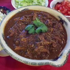 A unique blend of spices and cocoa powder turns into a rich and complex mole sauce after a long simmer in the slow cooker. Along with the tender chicken, it's a great filler for soft tortillas, or as a dip with corn chips. Spicy Recipes, Slow Cooker Recipes, Mexican Food Recipes, Cooking Recipes, Mexican Dishes, Healthy Recipes, Chicken Mole Recipe, Mole Sauce, Comida Latina