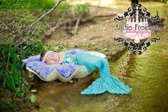 Newborn baby girl as mermaid beside water.  Outdoor newborn session. www.TheAthensNewbornPhotographer.com