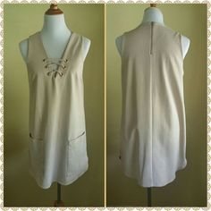 Gianni Bini Dress/Top This stunning champagne colored top can be also worn as a dress depending on your height. It has a very nice weight to it. It is made of 70%cotton/25%polyester/5%spandex and is fully lined with 100%polyester!!! It has large pockets on each side of the top/dress, zipper in the back, criss cross tie detailing on the front and comes up slightly at bottom on each side!!! So much fun!!! Gently worn only once!! No Trades Paypal Bundle and save 10% on 2 or more items!!! Gianni…