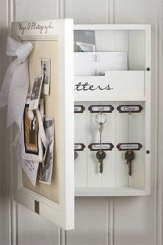 Box to keep keys.  Front bulletin board closes to keep out of sight.  Could do cork bulletin board or a coordinating fabric design to match decor. Can also have space to keep mail inside.  Label key hooks.