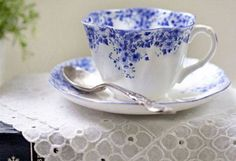 China tea cup with delicate blue flowers