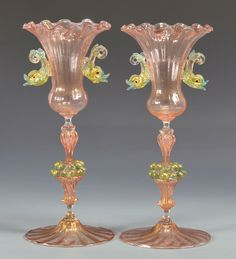 Pair of early Venetian or Murano glass chalices, goblets or vases, hand blown pink glass bodies with gold flecks, with applied green-gold dolphin handles on the sides, the stems adorned with cluste… Murano Glass Vase, Cobalt Glass, Turquoise Glass, Venetian Glass, Antique Glass, Vases, Antique Perfume Bottles, Mosaic Diy, Fire Glass