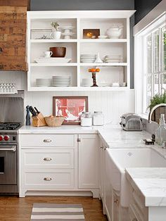 Farmhouse sink, shaker cabinets, open cabinetry, cabinet pulls, reclaimed wood and beautiful countertops
