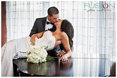 bride and groom portrait on the piano at the Westin in Charlotte NC. Click photo for Fusion's Wedding Day Photography Timeline, Minute by Minute