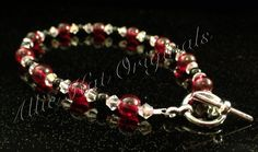 Red and black glass beads with Swarovski. https://www.etsy.com/your/listings?ref=si_your_shop