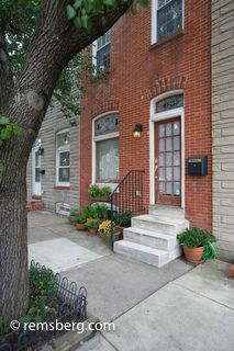 Iconic marble stoop in front of a Baltimore rowhouse  by Remsberg Photos, via Flickr
