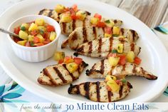 This easy grilled chicken's tropical flavors are like a Caribbean vacation for your taste buds!The combination of herb seasoned grilled chicken with a sweet-n-spicy pineapple salsa makes thi…