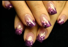 Gorgeous french style nails with purple glittery tip with pink flower on each nail...Have people amazed at prom