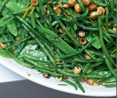 """French beans and mangetout with hazelnut and orange l (""""Mangetout"""" – meaning """"eat it all"""" – refers to snow or snap peas.) French beans and mangetout with hazelnut and orange l (""""Mangetout"""" – meaning """"eat it all"""" – refers to snow or snap peas. Green Bean Salads, Green Bean Recipes, Vegetable Recipes, Green Beans, Vegetarian Recipes, Cooking Recipes, Healthy Recipes, Beans Recipes, Vegetable Salad"""