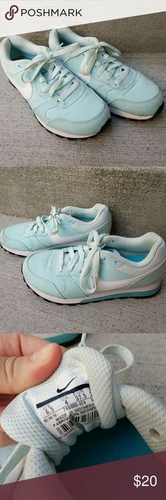 Tiffany Blue Nikes Size 6.5 excellent condition Tiffany blue Nikes. MD Runner 2 style. Some slight discoloration that could be removed in the washing machine. Imperfections reflected in price. Nike Shoes Athletic Shoes