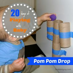 pom pom drop activity for baby - the baby in these pictures is 10 months old - i'm going to try this as soon as the LL stops putting everything in his mouth - or find bigger pom poms