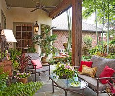 Extend Living Space-Extend your indoor living space outside by outfitting a covered porch with creature comforts. Here, outdoor furniture featuring soft cushions and colorful accent pillows give the space a living room-like feel. A ceiling fan adds to the comfort.