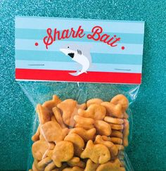 Shark bait treat toppers on goldfish snacks