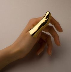 full finger ring---ive heard of Goldfinger but this is wild