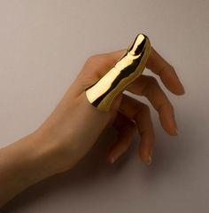 full finger ring---ive heard of Goldfinger but this is wild