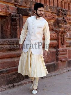 Off white color jodhpuri jacket invented on jacquard designed in angrakha pattern and cutdana, zari work. Item Code: SKHH09LJN http://www.bharatplaza.com/new-arrivals/mens-anarkali.html