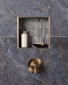 Make it shine! Brushed bronze details beautifully pull out the warm veining in this exquisite Aqua Blue tile, while also highlighting the iridescent qualities of the Glass Silver mosaic. Bathroom Niche, Shower Niche, Bathroom Trends, Bathroom Goals, Bathroom Inspo, Bathroom Renovations, Bathroom Ideas, Master Bath Shower, Master Bathroom