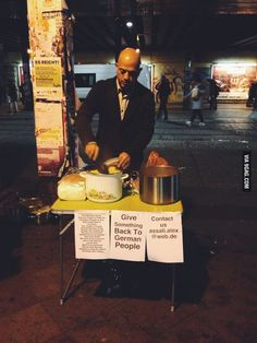 """Syrian refugee hands out food to homeless in Germany to """"give something back"""""""