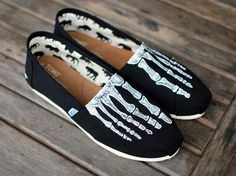 This pair of custom, hand painted black canvas classic TOMS shoes features the X-ray of your feet, so you can see the skeleton foot bones, as you would see if you could look through your TOMS and the