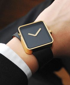 Tilted watch. I would never be able to wear this because it would drive me crazy. But it looks cool