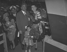 African American operatic singer Anne Wiggins Brown (1912-2009) readies the champagne bottle in order to christen the SS Frederick Douglas, a Liberty class cargo ship, at the Baltimore Bethlehem-Fairfield shipyards on May 23, 1943. Less than four months after this photo was taken, the Frederick Douglas was torpedoed by German U-boats and was lost in mid-Atlantic. A British rescue vessel saved all hands plus one female stowaway.