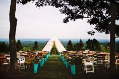 Wes Anderson-inspired ceremony decor -- love the tipi!
