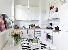 how to avoid hard-to-access corner cabinets -- just make another room's corner jut into the kitchen, so the space is not wasted. Beautiful Small Apartment Only 36 Square Meters