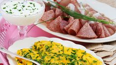 My Norwegian in-laws' holiday family brunch spreads always includes scrambled eggs (eggerøre), sour cream with dill (rømme med dill), norwegian cured dried sliced meats (spekemat) and norwegian cracker-like bread (flatbrød)