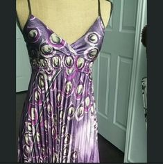 Long Purple Peacock Prom dress Perfect for prom, homecoming, graduation, resort, a wedding, or any other formal event! This beautiful gown features: - Tag says One size, but dress form is small - Elastic waistline for comfort - Flattering High Waist - Defined bust (cups) - V-Neck w/ asymmetrical bust so you determine how much cleavage is shown. - Adjustable skinny straps - Natural pleats Never worn & includes tags. Smooth to the touch. Perfect for pictures, as it shines beautifully w/ flash…
