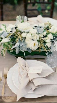 ideas on the flowers if you are leaning towards white/blues and keeping linens in neturals then.
