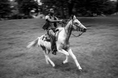 Shahir gallops across a small open field in the center of Clark Park in West Philadelphia. 'What I like is the rush. I feel like a different person when I ride,' Shahir said.