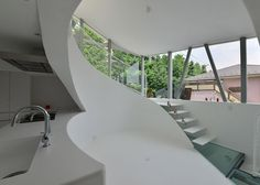 Tokyo house featuring a curvy interior and glass floors.