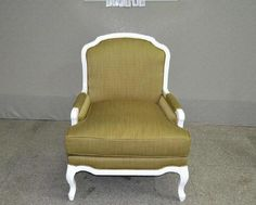 Armchair in white finish from and fabric upholstery.