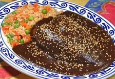 Mole Poblano – grilled chicken,  mole sauce with rice. A a traditional Mexican dish for Cinco de Mayo.