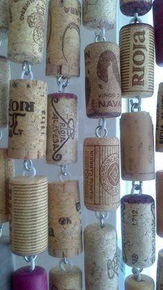 A curtain made of wine bottle corks. Awesome!