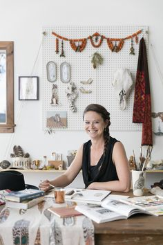 Founder and Designer of Brooklyn / Wyoming based company Coral & Tusk at work in her studio.