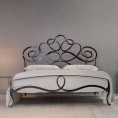 What is Wrought Iron Bed? Wrought iron is iron alloy with very low carbon. Wrought iron contains less carbon than cast iron, making … Wrought Iron Bed Frames, Wrought Iron Decor, Wrought Iron Headboard, Iron Furniture, Bedroom Furniture, Furniture Design, Rod Iron Beds, Iron Work, Metal Beds