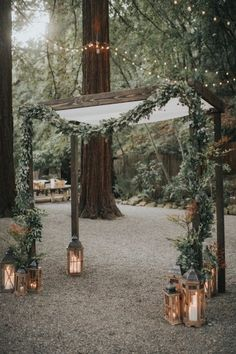 rustic fall greenery and lantern wedding arch #weddings #weddingcolors #weddingideas #springwedding #himisspuff #neutral #greenery #greeneryweddings