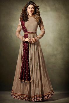 Beautiful Beige & Magenta Color Net Fabric Embroidered Attractive Look Stylish Occasionally Party Wear Gown Style Suit #mugdha #premiumcollection #weddingsuits #partycollection #floorlength #dresses #salwarsuits #salwarkameez #gownstyle #embroidery #traditional #fashion #style #beauty #newarraival #stonework #georgette #fancyfabric #besltstyle #yokesuits #traditionalanarkali #zariwork #usa #uk #australia #france #saudi