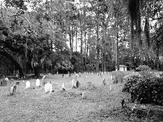 BEHAVIOR CEMETERY, SAPELO ISLAND, GEORGIA, a post-Civil War African American burial ground. The Cemetery reflects African American burial customs. Belongings of the deceased are often placed on the grave: oil lamps (to furnish light through the unknown paths), and alarm clocks (to sound on Judgement Day). It is likely that the cemetery was originally a Slave Burial Ground, located near former Slave Quarters of Thomas Spalding's Plantation. The oldest tombstone death date is 1890.