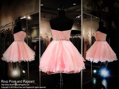 This super cute short homecoming dress features a lace sweetheart bodice with a waistband beaded with iridescent AB stones. The skirt has multiple layers of tulle for a full effect. Available in pink and it's at Rsvp Prom and Pageant, Atlanta, Georgia!