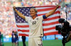 United States' Abby Wambach holds up the U.S. flag as she celebrates after the U.S. beat Japan 5-2 i... - AP Photo/Elaine Thompson