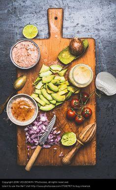 ingredient for tuna salad: fresh raw tuna, acovado, onions, tomato and chilli sauce