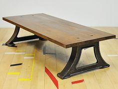 Hardwood printer table with cast iron legs. Perfect coffee table size and height.