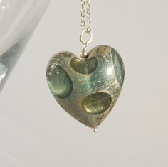 blue grey murano glass heart with white gold foil pendant and silver chain. £35.00
