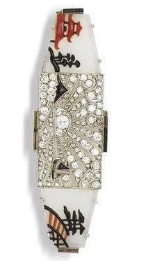An Art Deco frosted glass, diamond, onyx and enamel brooch, circa 1920. The…